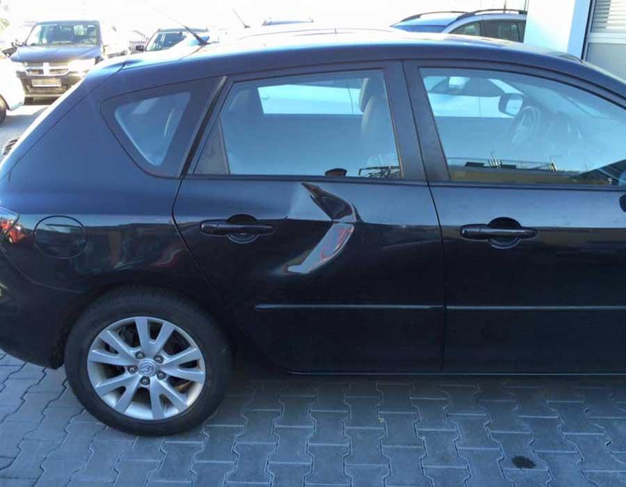 Delle in hinterer Fahrzeugtür - Beulendoktor und Hagelschaden-Reparatur in Sindelfingen - Dent Repair Team
